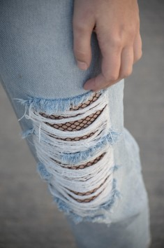 Fish nets and ripped jeans